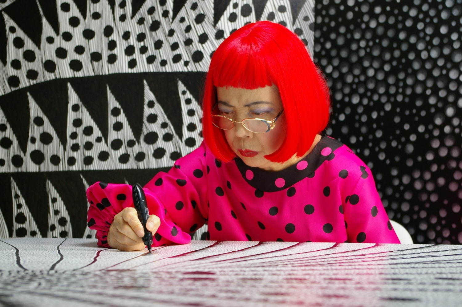 Artist Yayoi Kusama drawing in KUSAMA -INFINITY.