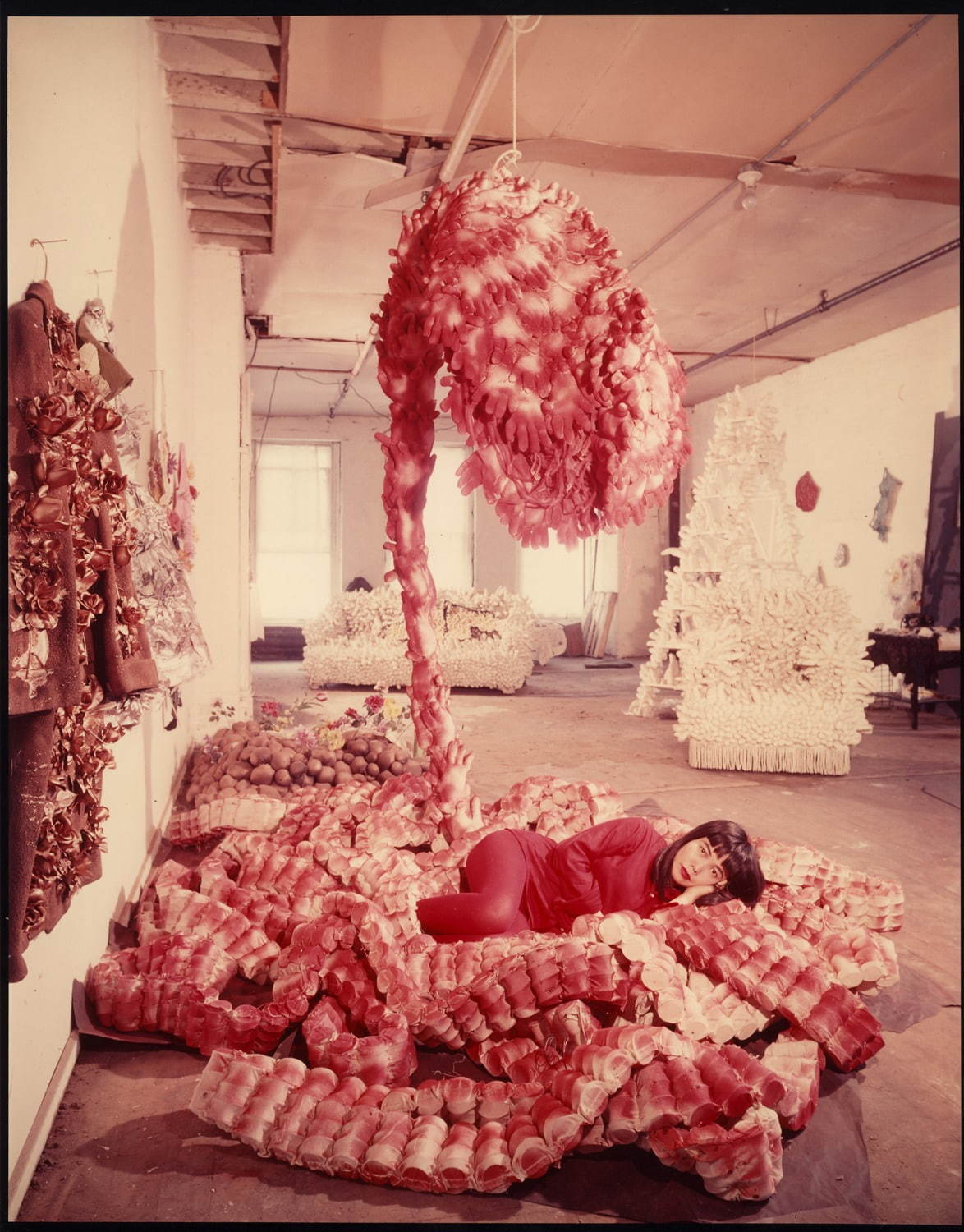 "Peter Moore, Photo of Yayoi Kusama with ""My Flower Bed"" in her NYC studio, c. 1965 